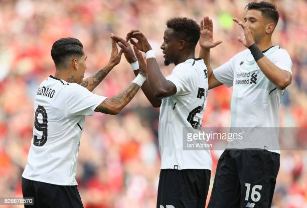 Roberto Firmino of Liverpool celebrates scoring their teams first goal with teammates during the Pre Season Friendly match between Liverpool and...