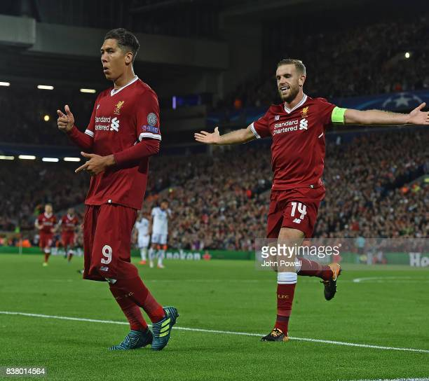 Roberto Firmino of Liverpool celebrates the forth goal during the UEFA Champions League Qualifying PlayOffs round second leg match between Liverpool...