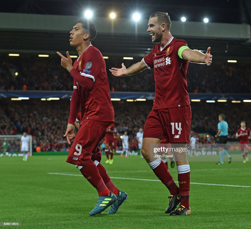Roberto Firmino of Liverpool celebrates the forth goal during the UEFA Champions League Qualifying Play-Offs round second leg match between Liverpool FC and 1899 Hoffenheim at Anfield on August 23, 2017 in Liverpool, United Kingdom.