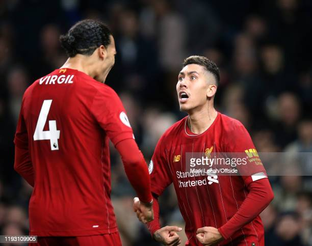 Roberto Firmino of Liverpool celebrates the opening goal with Virgil van Dijk. During the Premier League match between Tottenham Hotspur and...