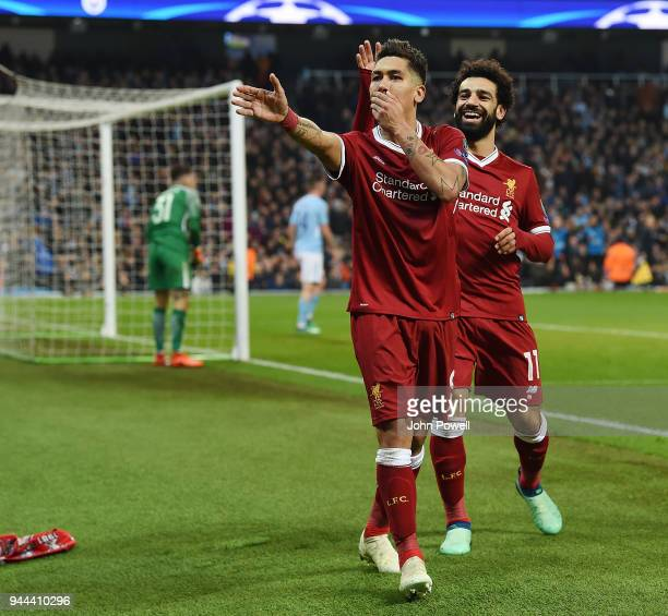 Roberto Firmino of Liverpool celebrates the second goal during the UEFA Champions League Quarter Final Second Leg match between Manchester City and...