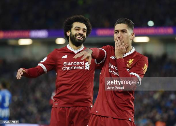 Roberto Firmino of Liverpool Celebrates the third goal during the Premier League match between Brighton and Hove Albion and Liverpool at Amex Stadium...