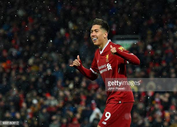 Roberto Firmino of Liverpool celebrates the third goal during the Premier League match between Liverpool and Watford at Anfield on March 17 2018 in...