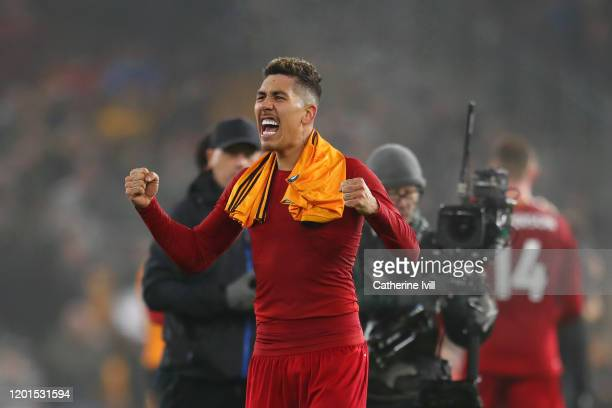 Roberto Firmino of Liverpool celebrates victory after the Premier League match between Wolverhampton Wanderers and Liverpool FC at Molineux on...