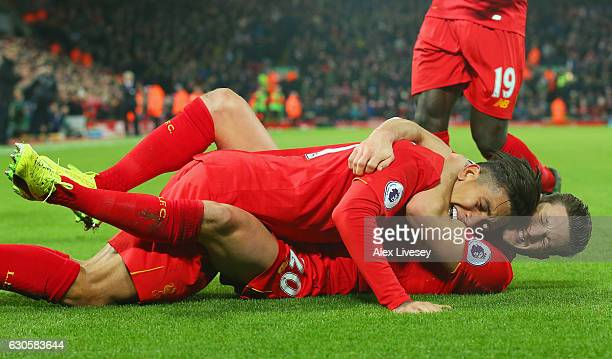 Roberto Firmino of Liverpool celebrates with Adam Lallana as he scores their second goal during the Premier League match between Liverpool and Stoke...