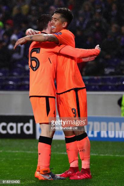 Roberto Firmino of Liverpool celebrates with Andrew Robertson after scoring his sides fourth goal during the UEFA Champions League Round of 16 First...