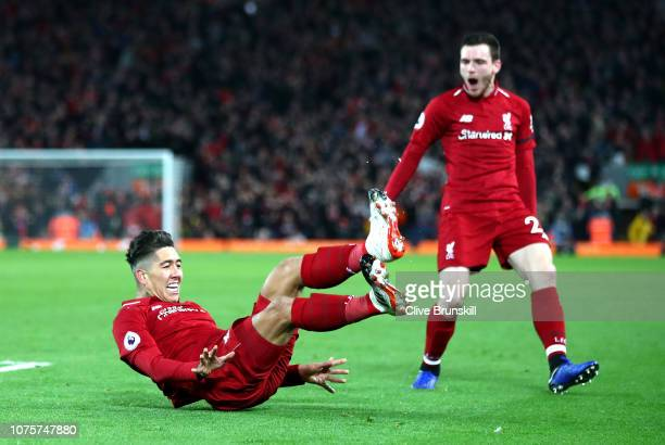 Roberto Firmino of Liverpool celebrates with Andy Robertson after scoring his sides second goal during the Premier League match between Liverpool FC...