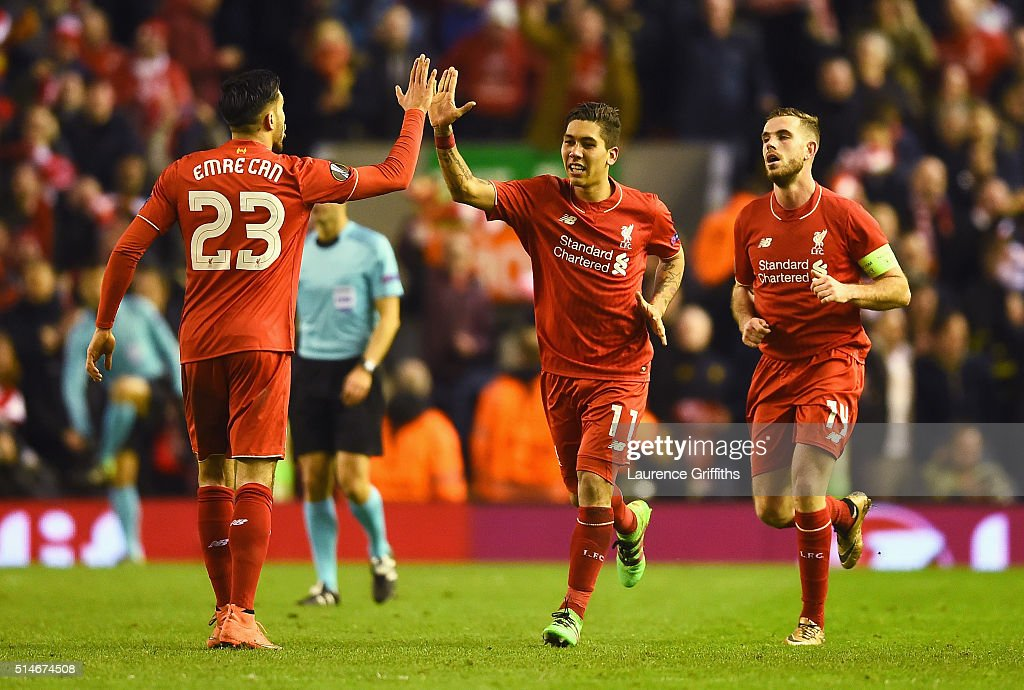 Roberto Firmino of Liverpool (11) celebrates with Emre Can (23) as he scores their second goal during the UEFA Europa League Round of 16 first leg match between Liverpool and Manchester United at Anfield on March 10, 2016 in Liverpool, United Kingdom.