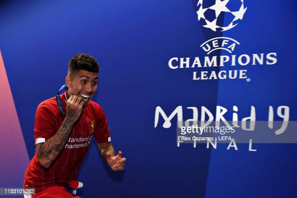 Roberto Firmino of Liverpool celebrates with his medal after the UEFA Champions League Final between Tottenham Hotspur and Liverpool at Estadio Wanda...