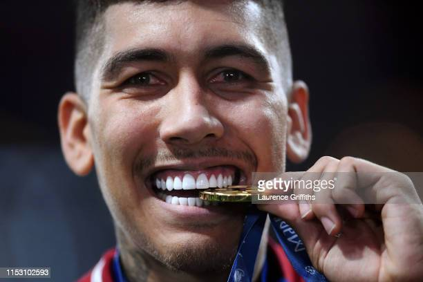 Roberto Firmino of Liverpool celebrates with his medal after winning the UEFA Champions League Final between Tottenham Hotspur and Liverpool at...