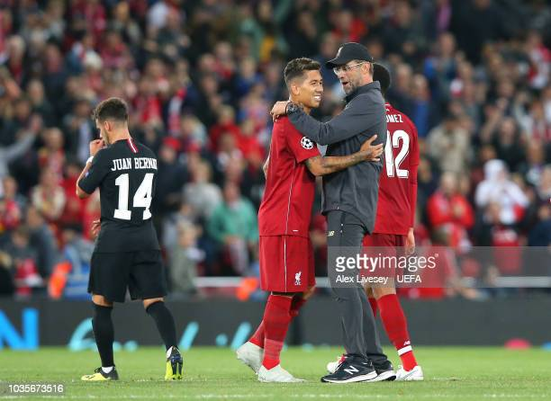 Roberto Firmino of Liverpool celebrates with Jurgen Klopp after the Group C match of the UEFA Champions League between Liverpool and Paris...