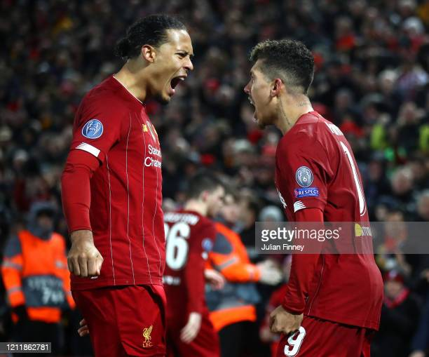 Roberto Firmino of Liverpool celebrates with li1 after scoring his team's second goal during the UEFA Champions League round of 16 second leg match...