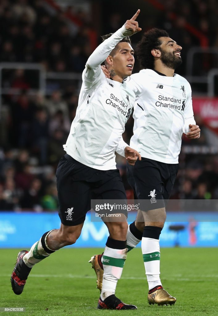 Roberto Firmino of Liverpool celebrates with Mohamed Salah after scoring his sides fourth goal during the Premier League match between AFC Bournemouth and Liverpool at Vitality Stadium on December 17, 2017 in Bournemouth, England.