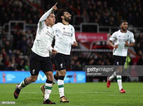 Roberto Firmino of Liverpool celebrates with Mohamed Salah after scoring his sides fourth goal during the Premier League match between AFC...