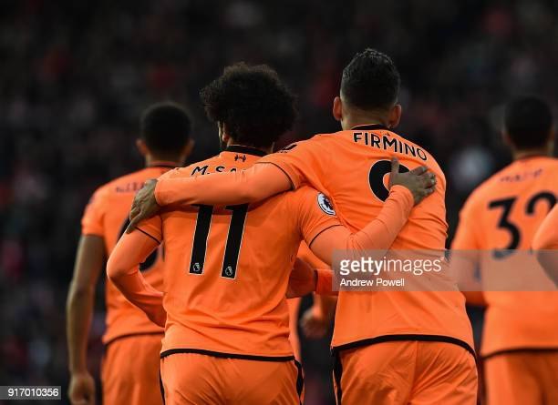 Roberto Firmino of Liverpool celebrates with Mohamed Salah after scoring the opening goal during the Premier League match between Southampton and...