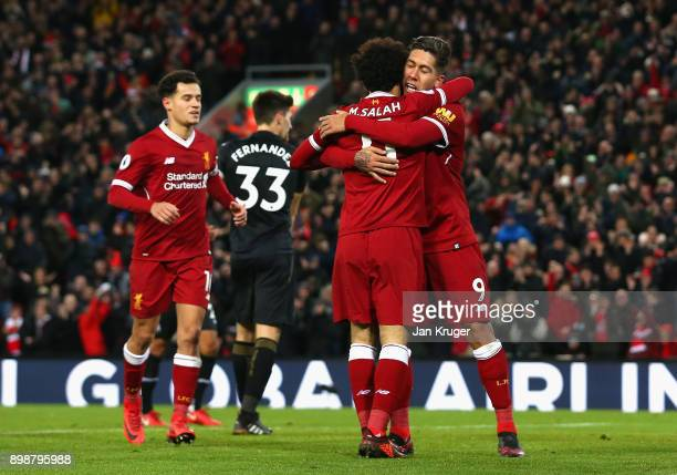 Roberto Firmino of Liverpool celebrates with Mohamed Salah of Liverpool after he scores his second and his sides fourth goal during the Premier...
