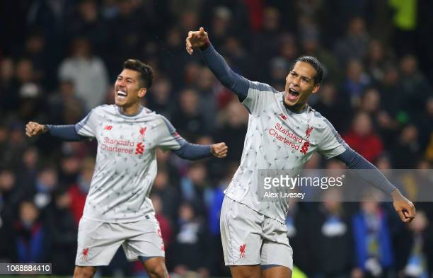Roberto Firmino of Liverpool celebrates with team mate Virgil van Dijk of Liverpool after scoring their team's second goal during the Premier League...