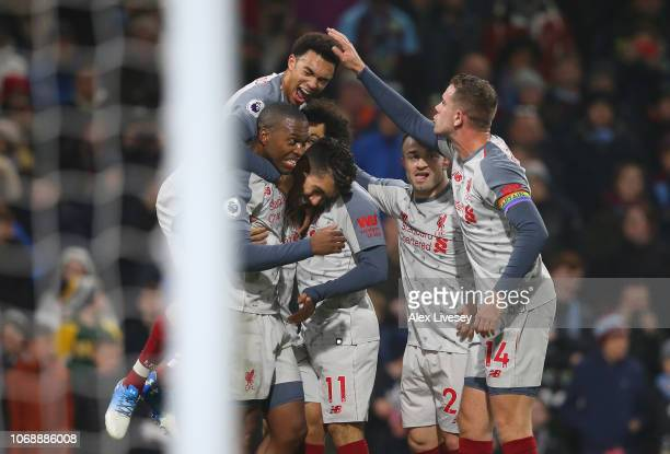 Roberto Firmino of Liverpool celebrates with team mates after scoring their team's second goal during the Premier League match between Burnley FC and...