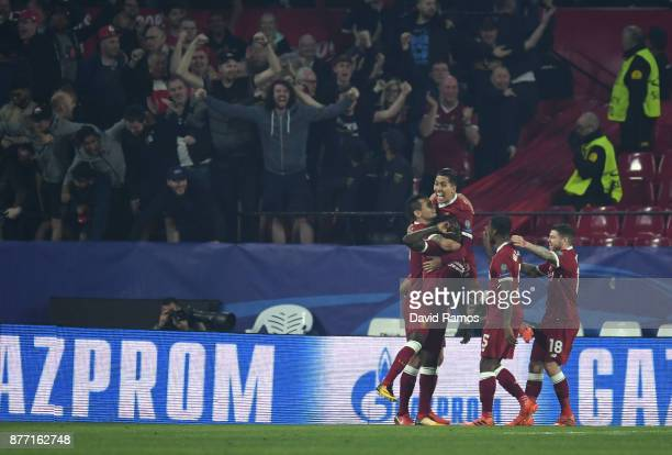 Roberto Firmino of Liverpool celebrates with team mates after scoring their sides third goal during the UEFA Champions League group E match between...