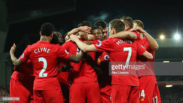 Roberto Firmino of Liverpool celebrates with team mates as he scores their second goal during the Premier League match between Liverpool and Stoke...