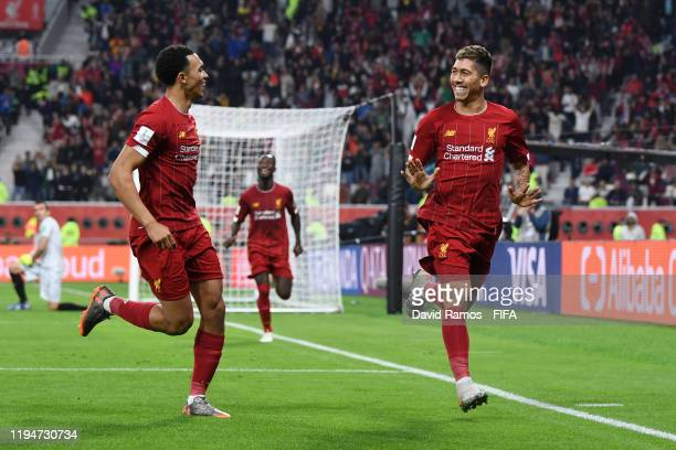 Roberto Firmino of Liverpool celebrates with teammate Trent Alexander-Arnold of Liverpool after scoring their team's second goal during the FIFA Club...