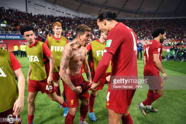 Roberto Firmino of Liverpool celebrates with teammate Virgil van Dijk of Liverpool after scoring his team's first goal during the FIFA Club World Cup...