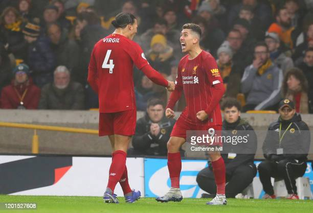 Roberto Firmino of Liverpool celebrates with team-mate Virgil van Dijk after scoring their second goal during the Premier League match between...