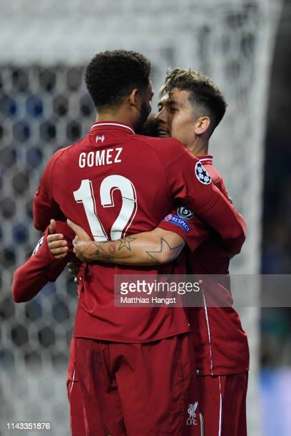 Roberto Firmino of Liverpool celebrates with teammates Mohamed Salah and Joe Gomez after scoring his team's third goal during the UEFA Champions...
