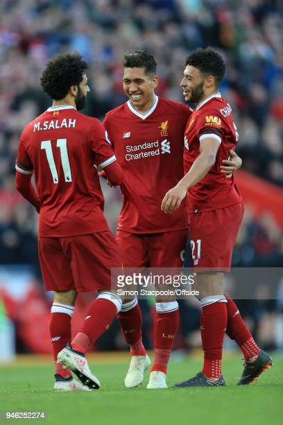 Roberto Firmino of Liverpool celebrates with teammates Mohamed Salah of Liverpool and Alex OxladeChamberlain of Liverpool after scoring their 3rd...