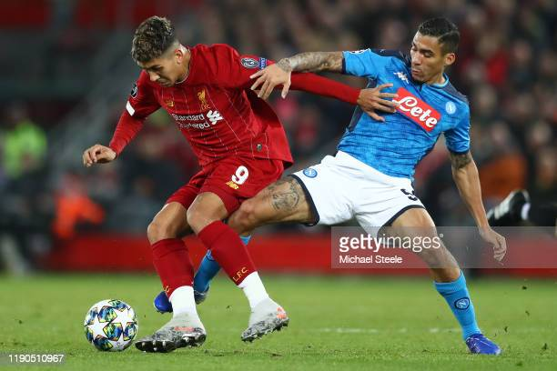 Roberto Firmino of Liverpool challenged by Allan of SSC Napoli during the UEFA Champions League group E match between Liverpool FC and SSC Napoli at...