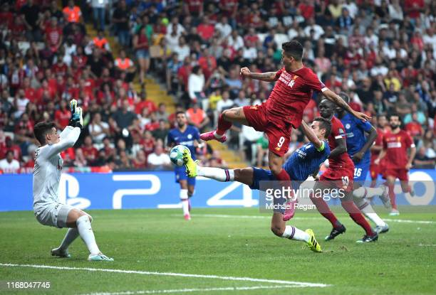 Roberto Firmino of Liverpool challenges for the ball with Cesar Azpilicueta of Chelsea which leads to Sadio Mane of Liverpool scoring his team's...