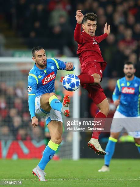Roberto Firmino of Liverpool challenges Nikola Maksimovic of SSC Napoli during the UEFA Champions League Group C match between Liverpool and SSC...