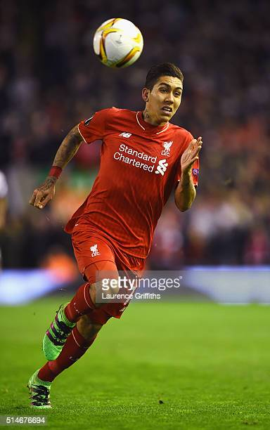 Roberto Firmino of Liverpool chases the ball during the UEFA Europa League Round of 16 first leg match between Liverpool and Manchester United at...