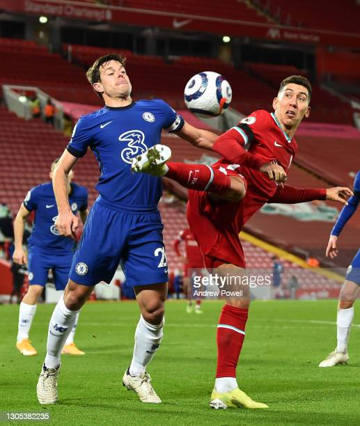 Roberto Firmino of Liverpool Chelsea's Cesar Azpilicueta during the Premier League match between Liverpool and Chelsea at Anfield on March 04, 2021...