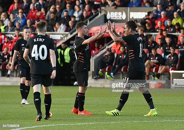 Roberto Firmino of Liverpool clebrates after scoring the fourth during the PreSeason Friendly bewteen Fleetwood Town and Liverpool at Highbury...