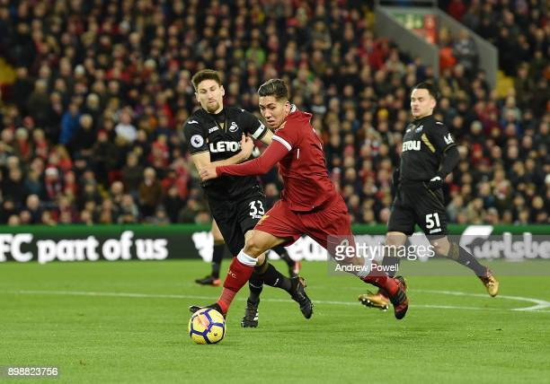 Roberto Firmino of Liverpool competes with Federico Fernandez of Swansea City comes close during the Premier League match between Liverpool and...