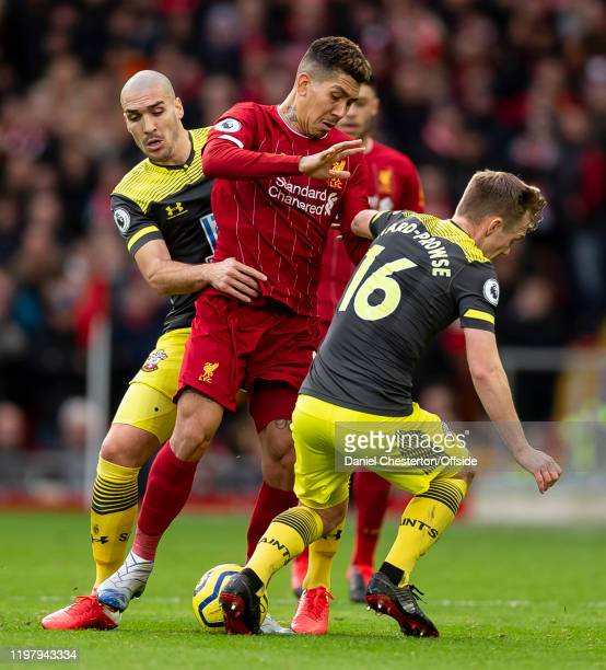 Roberto Firmino of Liverpool competes with James Ward-Prowse of Southampton and Oriol Romeu of Southampton during the Premier League match between...
