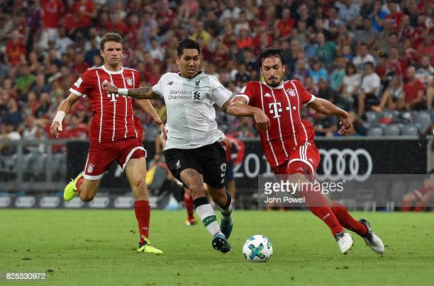 Roberto Firmino of Liverpool competes with Mats Hummels of Bayern Muenchen during the Audi Cup 2017 match between Bayern Muenchen and Liverpool FC at...