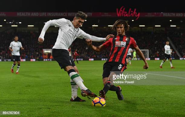 Roberto Firmino of Liverpool competes with Nathan Ake of AFC Bournemouth during the Premier League match between AFC Bournemouth and Liverpool at...