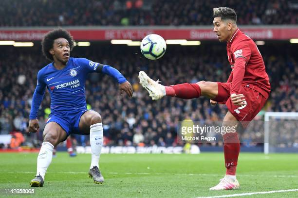 Roberto Firmino of Liverpool controls the ball from Willian of Chelsea during the Premier League match between Liverpool FC and Chelsea FC at Anfield...