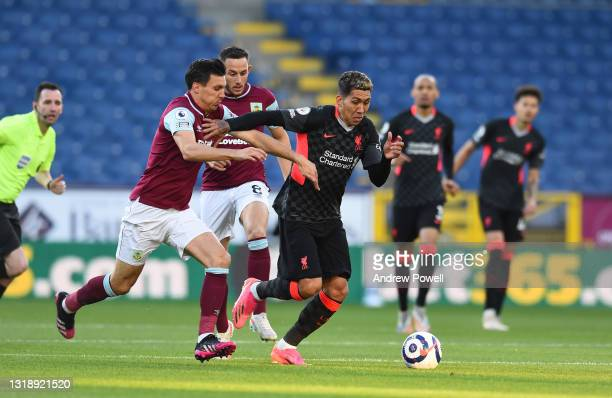 Roberto Firmino of Liverpool during the Premier League match between Burnley and Liverpool at Turf Moor on May 19, 2021 in Burnley, England.