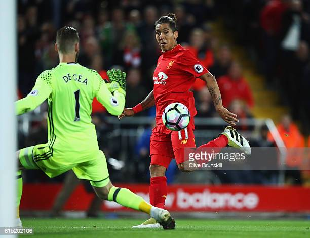 Roberto Firmino of Liverpool fails to score past David De Gea of Manchester United during the Premier League match between Liverpool and Manchester...