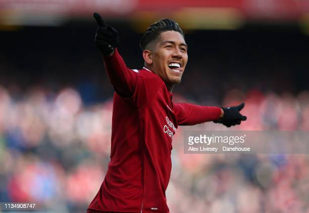 Roberto Firmino of Liverpool FC celebrates after scoring his second goal during the Premier League match between Liverpool FC and Burnley FC at...