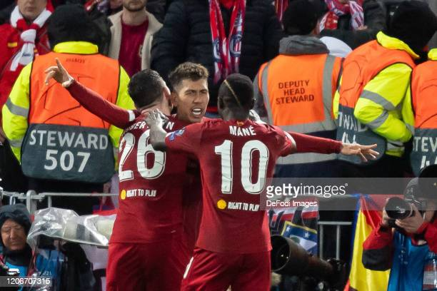 Roberto Firmino of Liverpool FC celebrates after scoring his team's second goal during the UEFA Champions League round of 16 second leg match between...