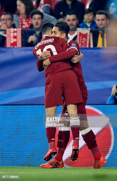 Roberto Firmino of Liverpool FC celebrates with his teammate Philippe Coutinho of Liverpool FC after scoring the opening goal during the UEFA...