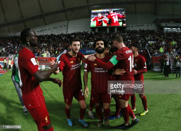 Roberto Firmino of Liverpool FC celebrates with team mates after his goal of 12 during the Semifinals Match between Monterrey and Liverpool FC at...