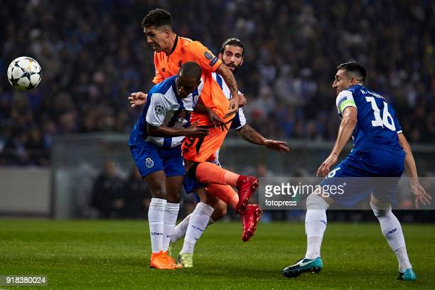 Roberto Firmino of Liverpool FC competes for the ball with Ricardo Pereira of FC Porto during the UEFA Champions League Round of 16 First Leg match...