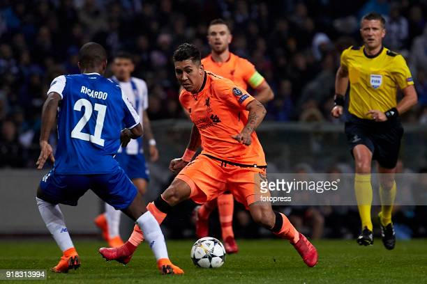 Roberto Firmino of Liverpool FC is challenged by Ricardo Pereira of FC Porto during the UEFA Champions League Round of 16 First Leg match between FC...