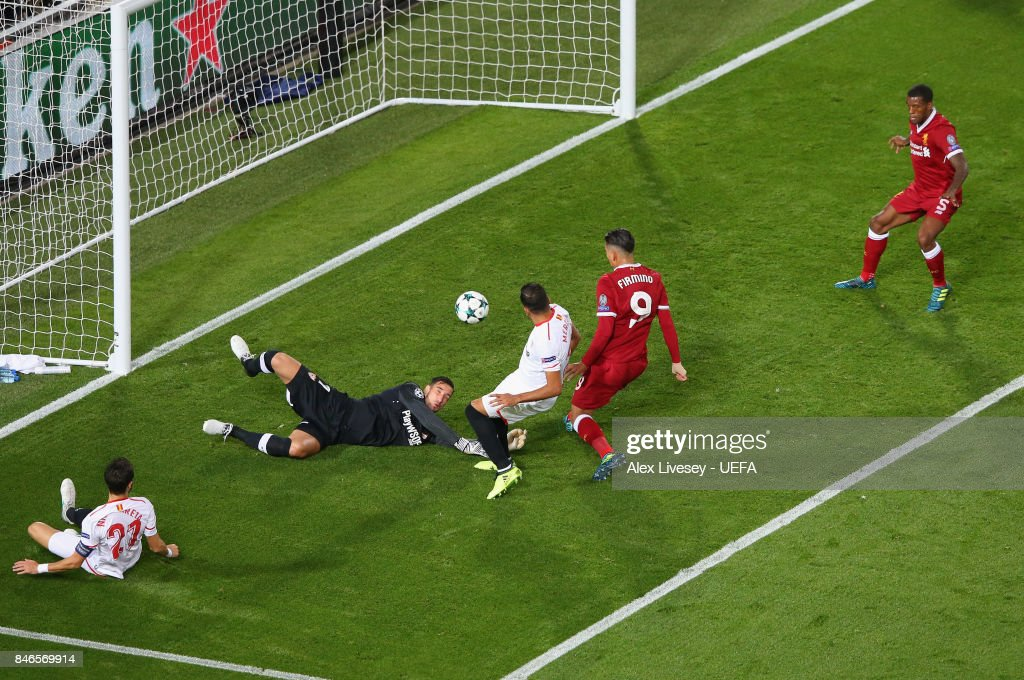 Roberto Firmino of Liverpool FC scores their first goal during the UEFA Champions League group E match between Liverpool FC and Sevilla FC at Anfield on September 13, 2017 in Liverpool, United Kingdom.