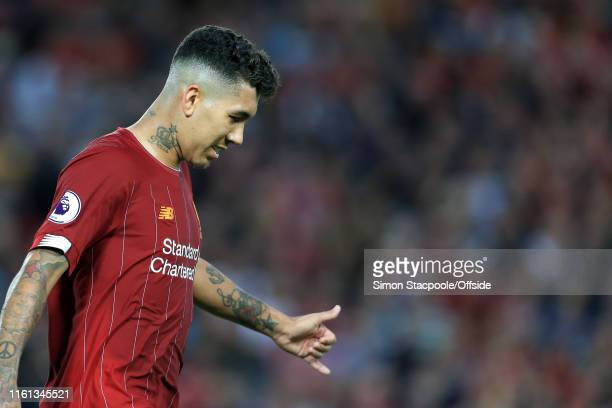 Roberto Firmino of Liverpool gestures during the Premier League match between Liverpool and Norwich City at Anfield on August 9 2019 in Liverpool...